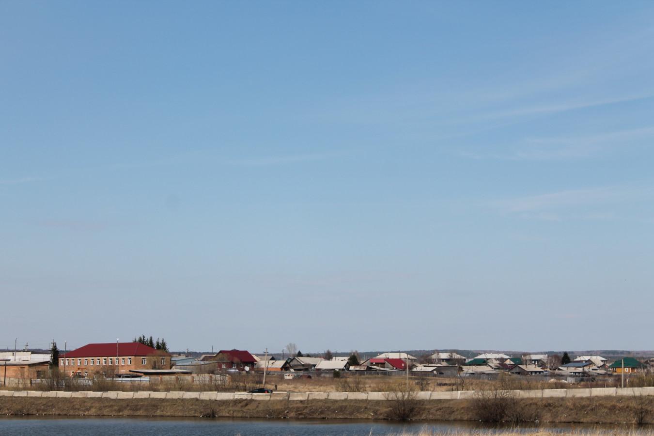 Вид на город с берега озера Дорожное